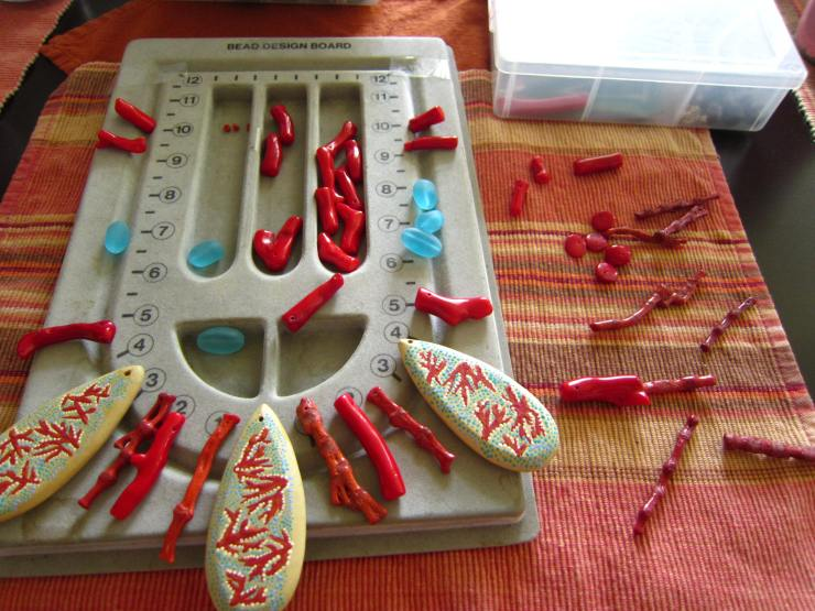 The pattern comes to me as I pull different beads.  Sometimes I will lay things out that work and some that don't.  The bead board is a great tool to play around with your design, store your different beads in the compartments and use as a guide for the overall length of your piece.