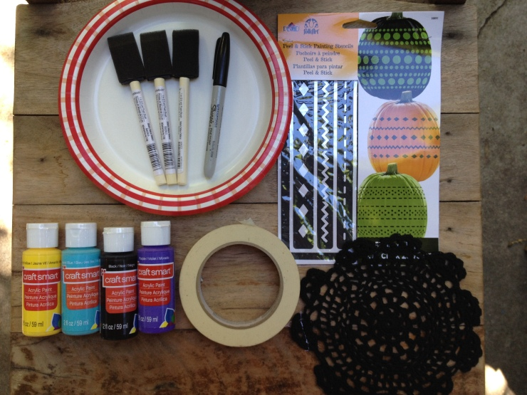 Painting Supplies: Paper plates for paint, brushes, marker, paint, tape, stencil and doily