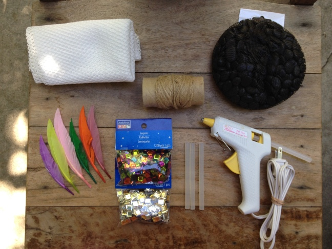 Decorating supplies: River rocks, feathers, sequins, twine, mesh, glue gun with glue sticks