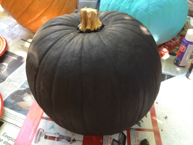 Step 1: Paint the entire pumpkin black and the stem gold.