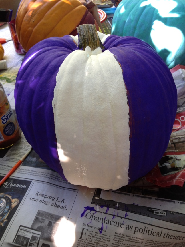 Step 2: Paint stripes white and the remainder of the pumpkin purple.  You could use any colors that excite you!