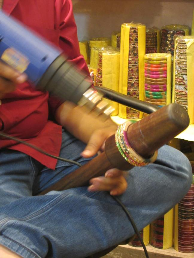 Bangles being heated and stretched.