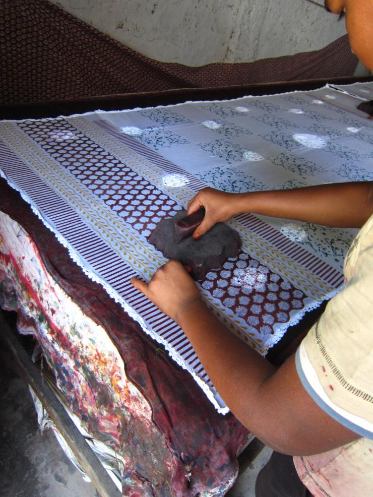 Each pattern on the textile uses a different stamp, applied in a layered pattern.