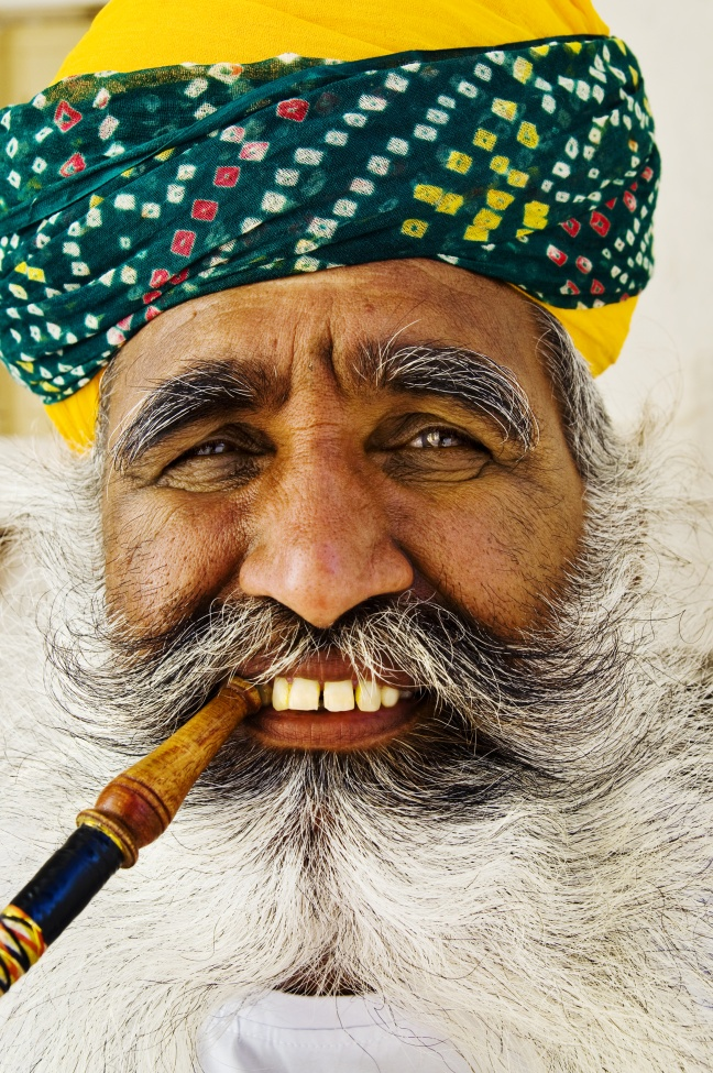 India Man Smoking Pipe Happiness Concept